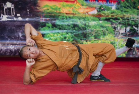 Shaolin monks does no-charge street show to promote chinese martial arts.