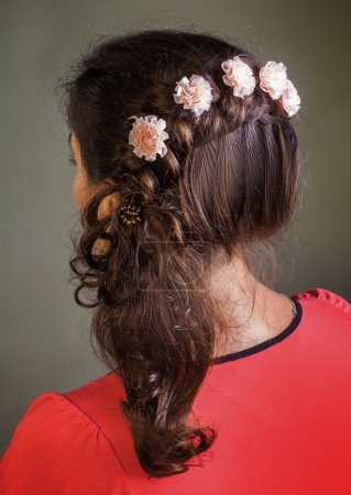 Brunette girl with floral barrettes