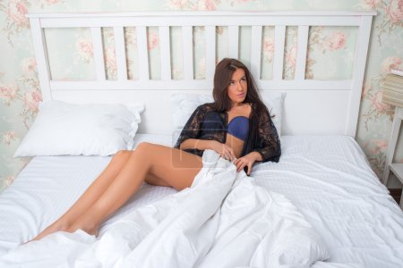 girl in lingerie on the bed