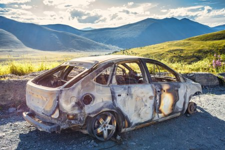 Burned car on the road