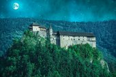 Scary castle in a forest at night with moon