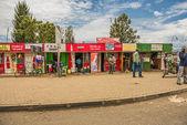 Shopping street scene with pedestrians in Naivasha, Kenya