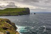 Giant  sea cliff and sea stacks on Faroe Islands