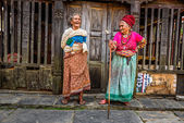 Two very old women discuss in Bandipur, Nepal