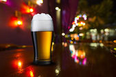 Glass of beer with bar scene