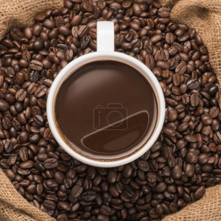 Photo for Cup of hot coffee on coffee beans - Royalty Free Image