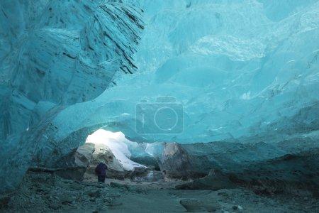Tourist  in Ice cave in a glacier