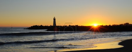 Panoramic landscape of Lighthouse silhouette at su...