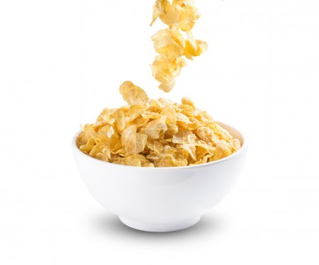 Photo for Cereal Corn Flakes Falling Into A Bowl on white background - Royalty Free Image