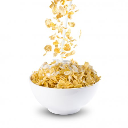 Photo for Corn Flakes and Milk Splash on Bowl of Cereal on white  background - Royalty Free Image