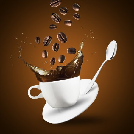 Coffee and beans splashing from cup