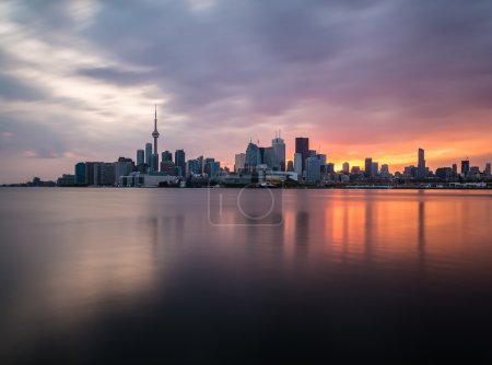 A view of the Toronto Skyline at sunset with refle...