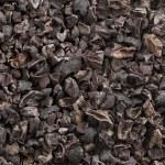 Background full of healthy tasty cacao nib...