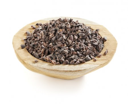 Healthy and tasty cacao nibs served in a wooden bo...