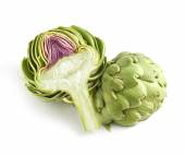 Whole and halved fresh artichoke