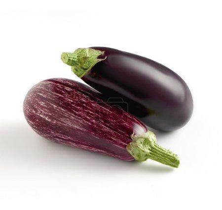 Two whole fresh aubergine varieties