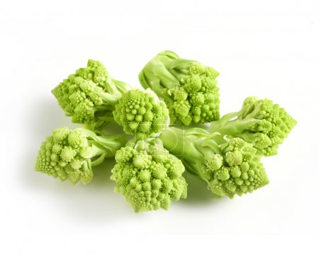 Cut florets of fresh green raw Romanesco broccoli ...