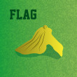 An isolated yellow flag on a green football field...