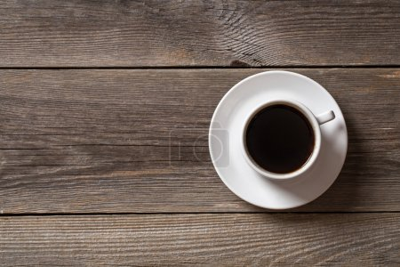Photo for Coffee cup on wooden table. View from top - Royalty Free Image