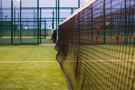 Paddle tennis net at night