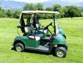 Two green golf cars