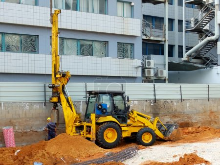 Bulldozer with bore pile rig at the construction s...