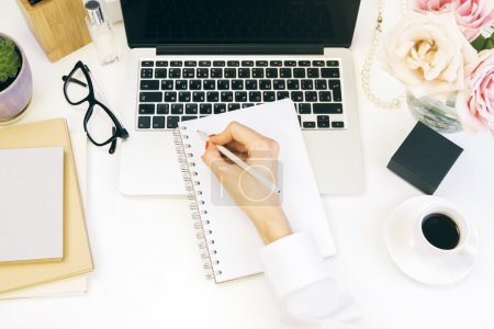 Female desktop writing
