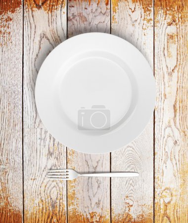 Empty plate on aged wood