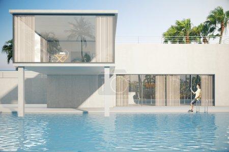 Photo pour Extérieur de maison luxueuse avec jeune mec à la piscine. Palmiers en arrière-plan. rendu 3D - image libre de droit