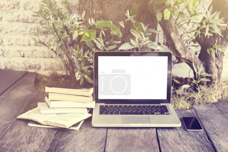 Photo for Blank laptop, books and cell phone, mock up - Royalty Free Image
