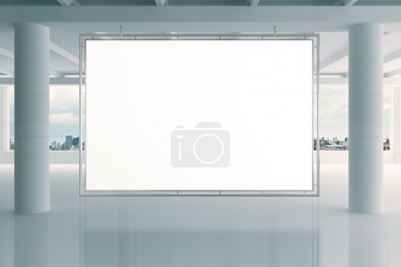 Blank white banner in modern empty open space office with big wi