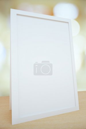 Blank white picture frame on the table, mock up