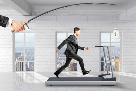 Profit-seeking concept with businessman running on a treadmill f