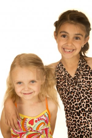 Two young happy girls wearing swimsuits standing and smiling