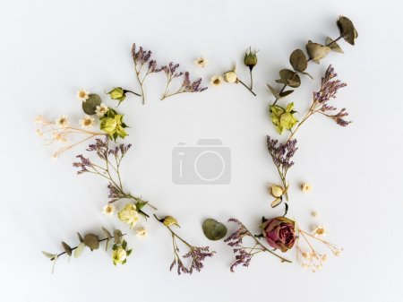 Frame of dry flowers background. Flat lay, top view