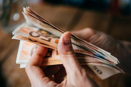 Euro bills in hands