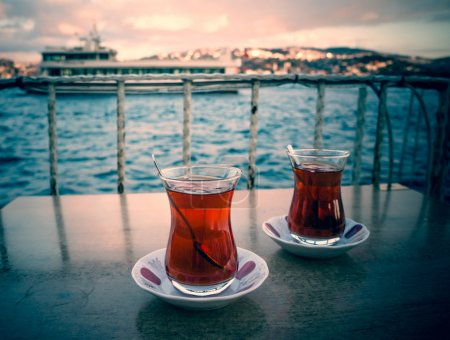 Photo for Two glasses of turkish tea on the table with Bosphorus on the background in Istanbul, Turkey. Toned image - Royalty Free Image