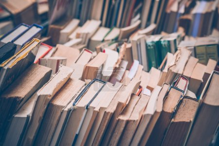 Photo for Many old books in a book shop or library. Toned image - Royalty Free Image