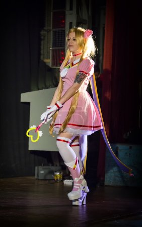 Girl on the stage during the festival cosplay costume