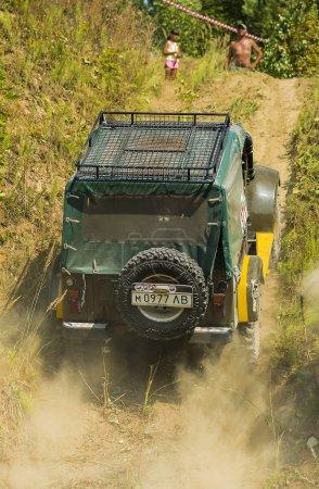 Off-road vehicle brand GAZ-69(UAZ) overcomes the track