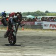 Постер, плакат: Unknown stunt biker entertain the audience
