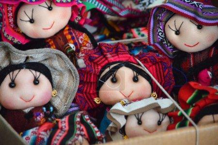 Traditional rag dolls on market basket