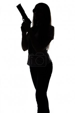 Silhouette of spy woman with gun