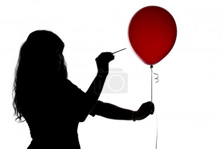 Photo for Silhouette of woman pierced with a needle balloon on white background - Royalty Free Image