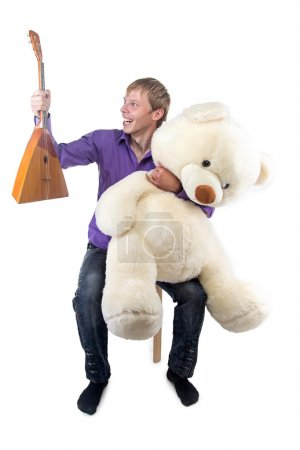 Photo for Image of smiling man with balalaika and teddy bear on white background - Royalty Free Image