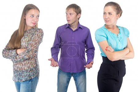 Puzzled blond man and two young women