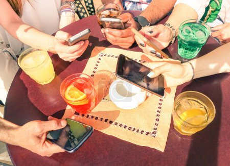 Photo for Close up of multiracial friends group in disinterest moment with mobile smart phone - Relationship apathy concept and addiction using smartphones -  People hands having fun on social media networking - Royalty Free Image