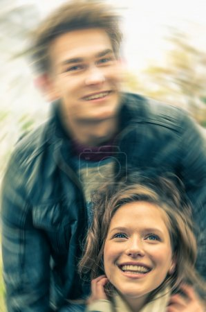 Young hipster couple of lovers at the beginning of a love story - Concept carefree life with the typical starting moments with ecstatic sensation of a neverending relationship