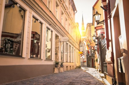 Vintage retro travel image of a narrow medieval street in old town Riga at sunset - Latvia - European capital of culture 2014