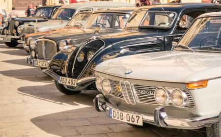 MDINA, MALTA - OCTOBER 10, 2014: vintage classic retro cars parked in San Pawl square. The ancient capital Mdina is a medieval walled town situated on a hill in the centre of the island